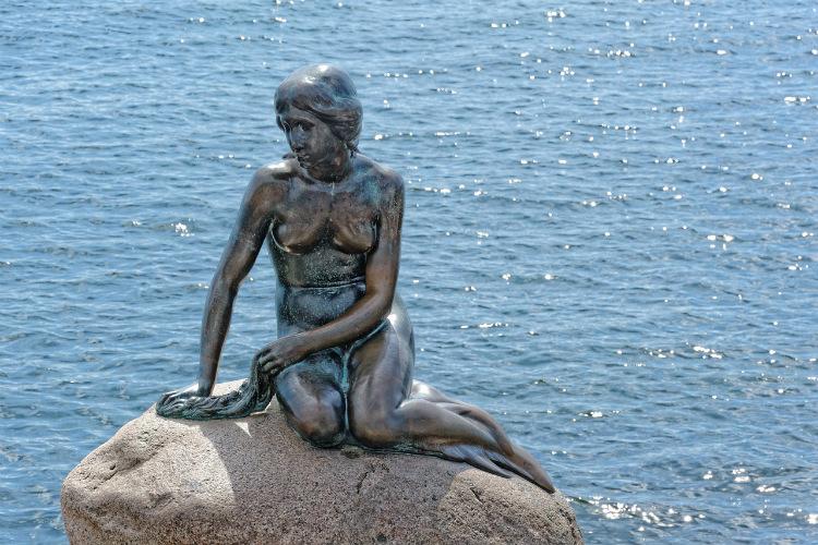 The bronze Little Mermaid statue sitting in Copenhagen harbour