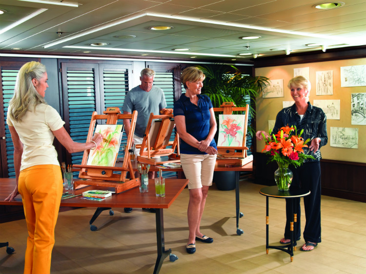 Solo cruise passengers taking part in an art lesson in Oceania's Artist Loft