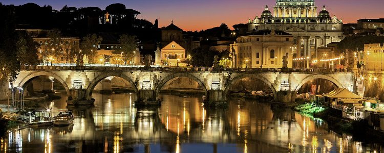 Rome illuminated at night and reflected in a river