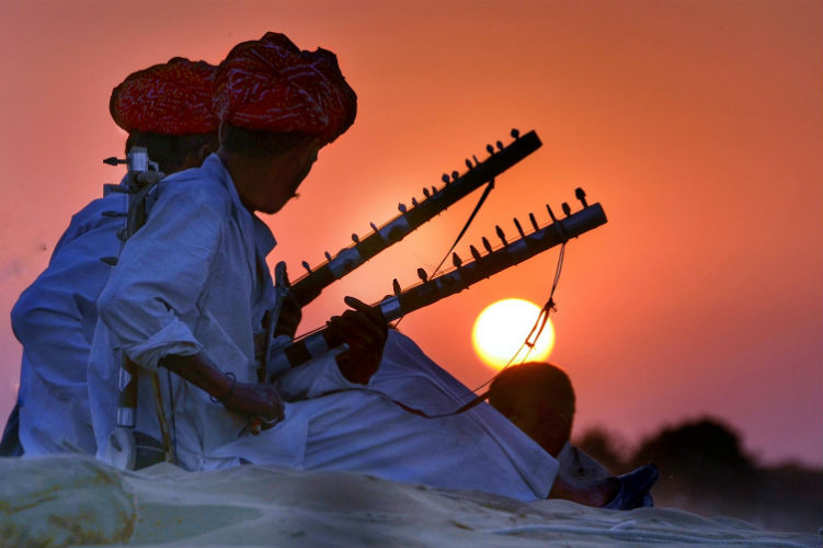 Rajasthan men playing in the sunset - India