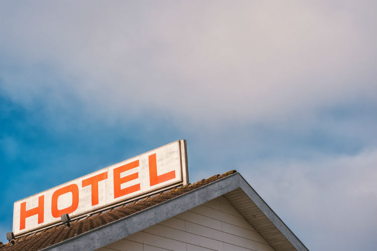 Hotel sign against a blue sky