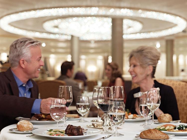 Couple enjoying dinner on-board Oceania