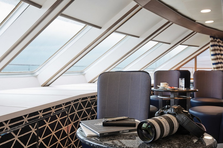 Camera and books on a table on-board the refurbished Silver Explorer