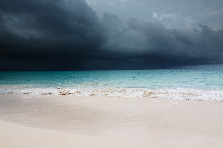 Dark, stormy skies rolling in over a Caribbean beach