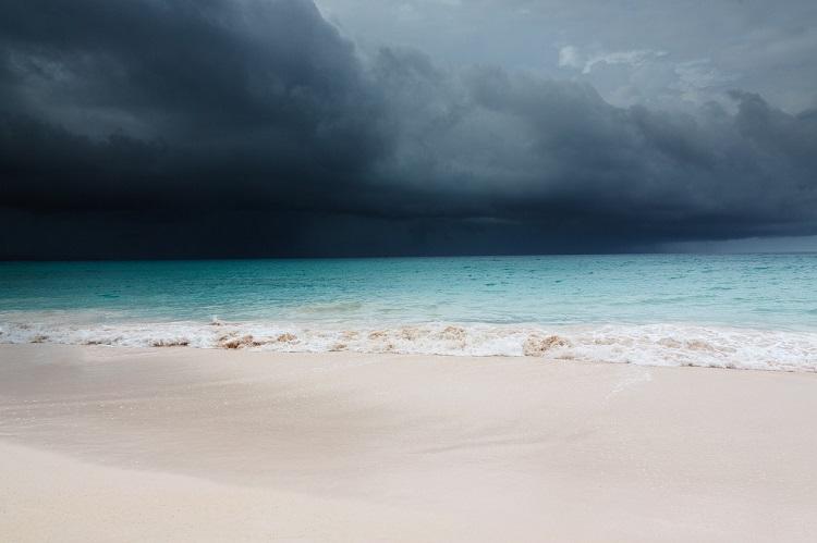 Dark, stormy skies rolling in over a Caribbean beach