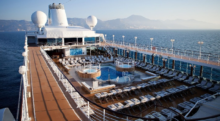 The pool and sun loungers on the top deck of Azamara Pursuit