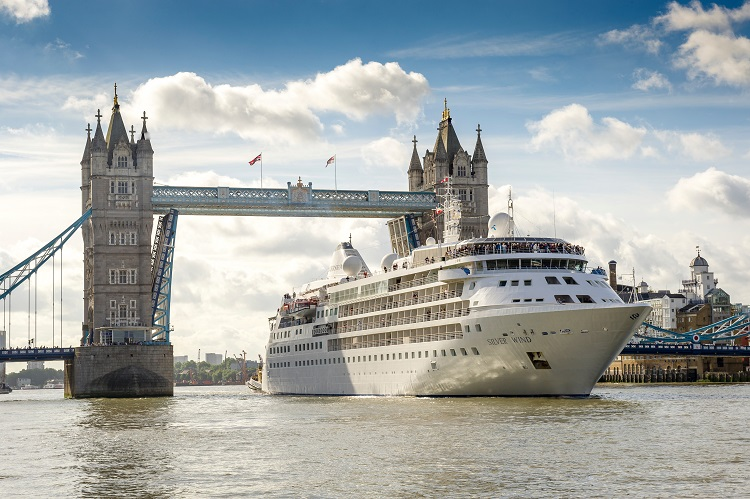 Silversea's Silver Wind cruise ship sailing under a bridge over the Thames in London