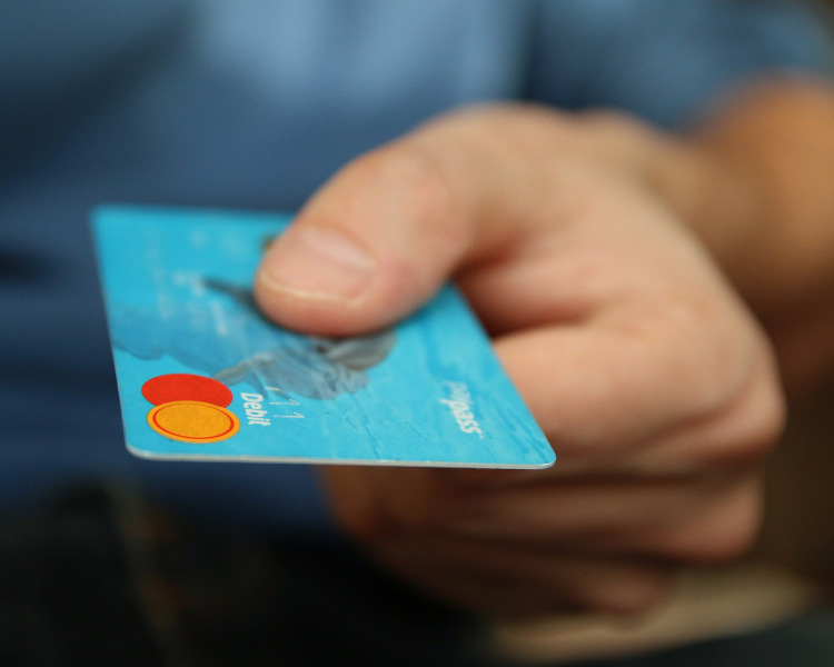 Card payment - Person holding card