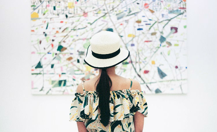 Lady viewing art in a gallery