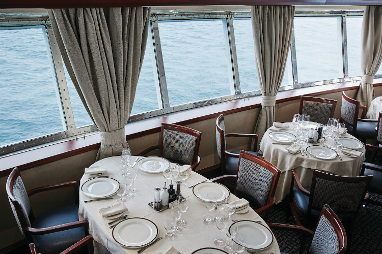 Tables in the sophisticated restaurant on-board Silver Explorer