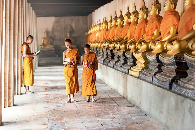 Buddhist priests in a temple in Rangoon in Myanmar