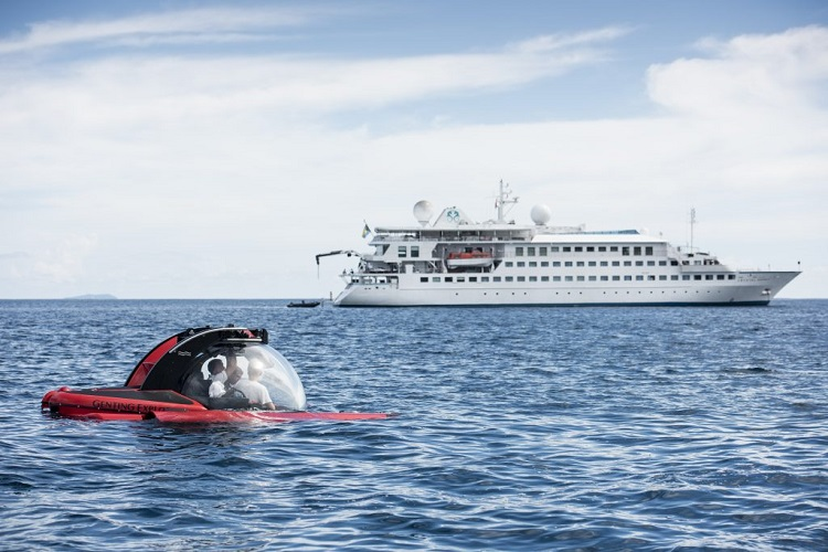 Crystal Esprit sailing with a submarine