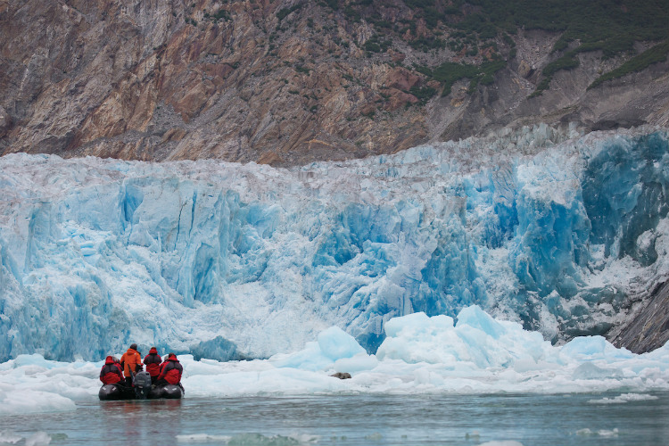 A Silversea Zodiac heading towards a glacier in Tracy Arm Fjord