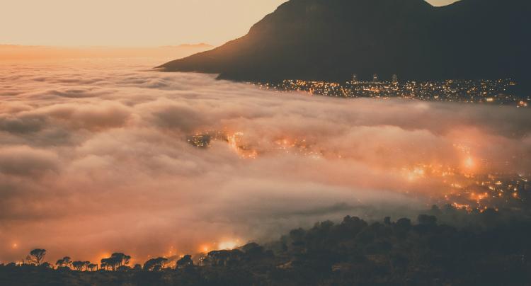 Mist descending over Cape Town at sunset