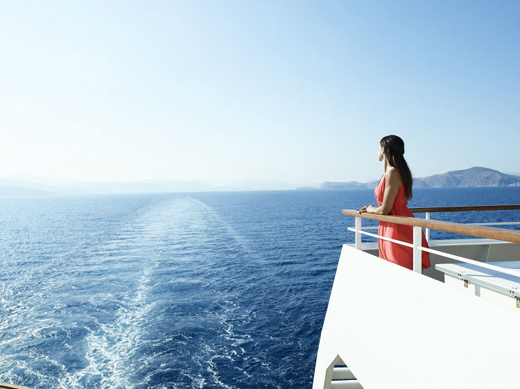 Woman overlooking a balcony on-board Seabourn