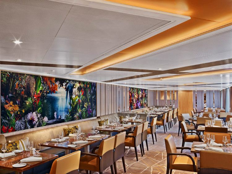The vibrant Colonnade restaurant on-board Seabourn Ovation