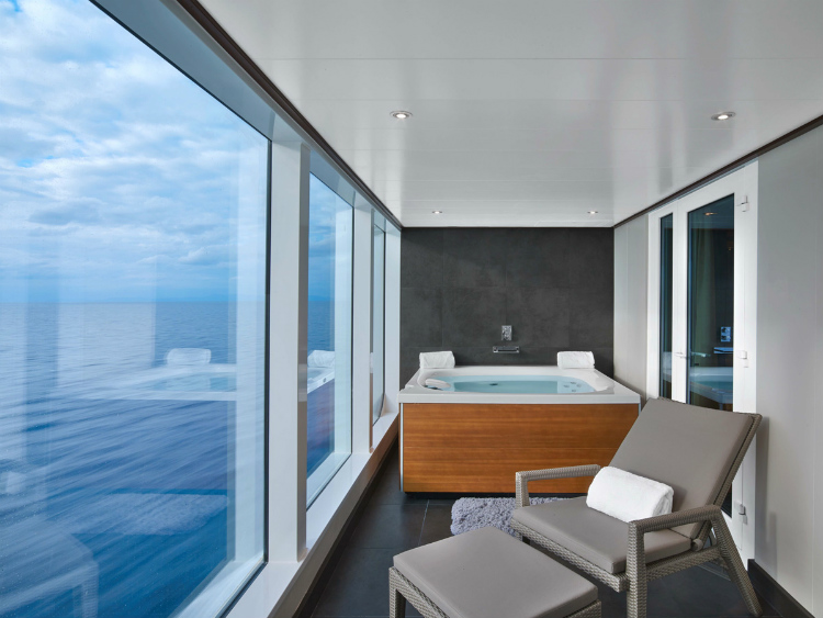 A sea-view jacuzzi in a Wintergarden Suite on-board Seabourn Ovation