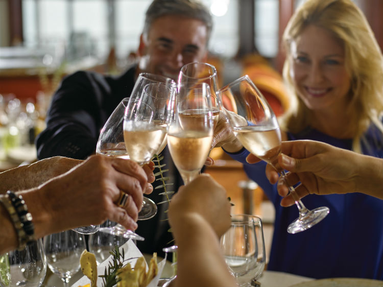 Group dining together with wine