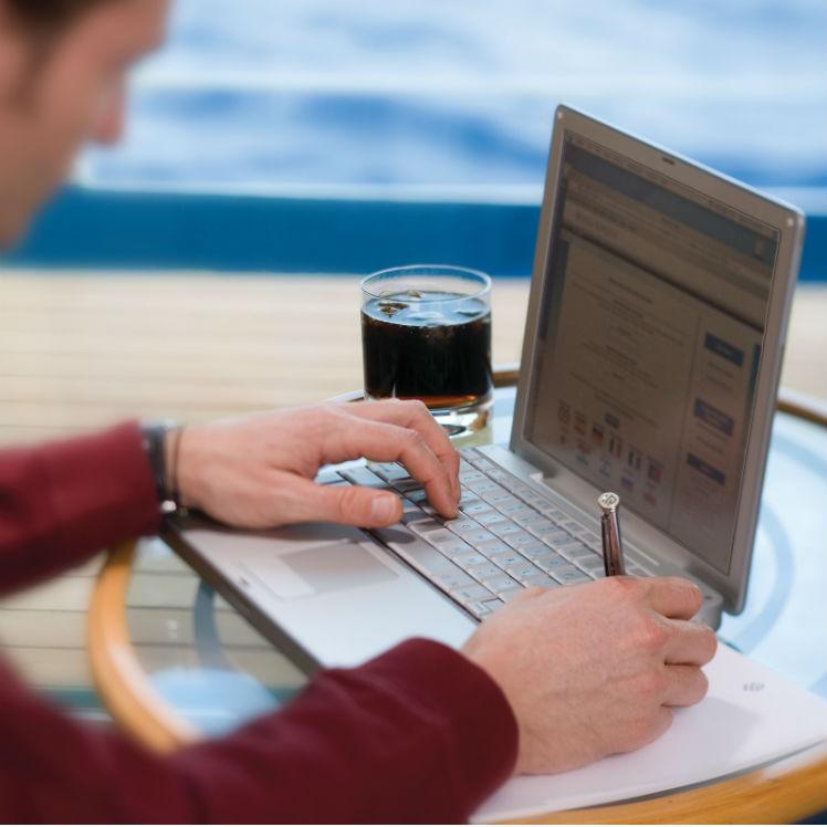 Man with laptop on-board Silversea cruise