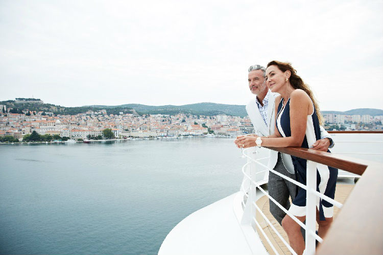 Couple at the balcony on-board Seabourn