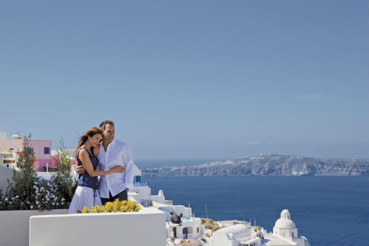 Couple overlooking a balcony - Santorini
